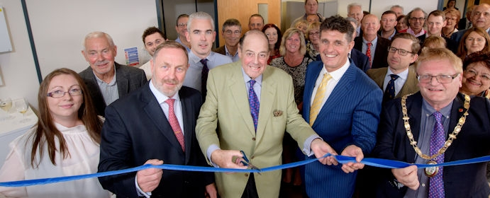 Sir Nicholas cuts the ribbon at the official opening of Mike Oliver Associates in Haywards Heath.
