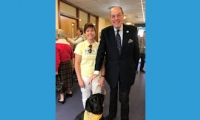Sir Nicholas at the official opening of Age UK East Grinstead and District with Millie the therapy dog.
